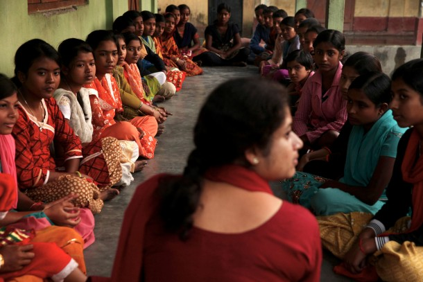 Ruma Chatterjee leads a girls group in rural West Bengal, India. They discussed teasing, the role of police, land rights, rape and abuse. (Erika Schultz/Seattle Times/MCT)