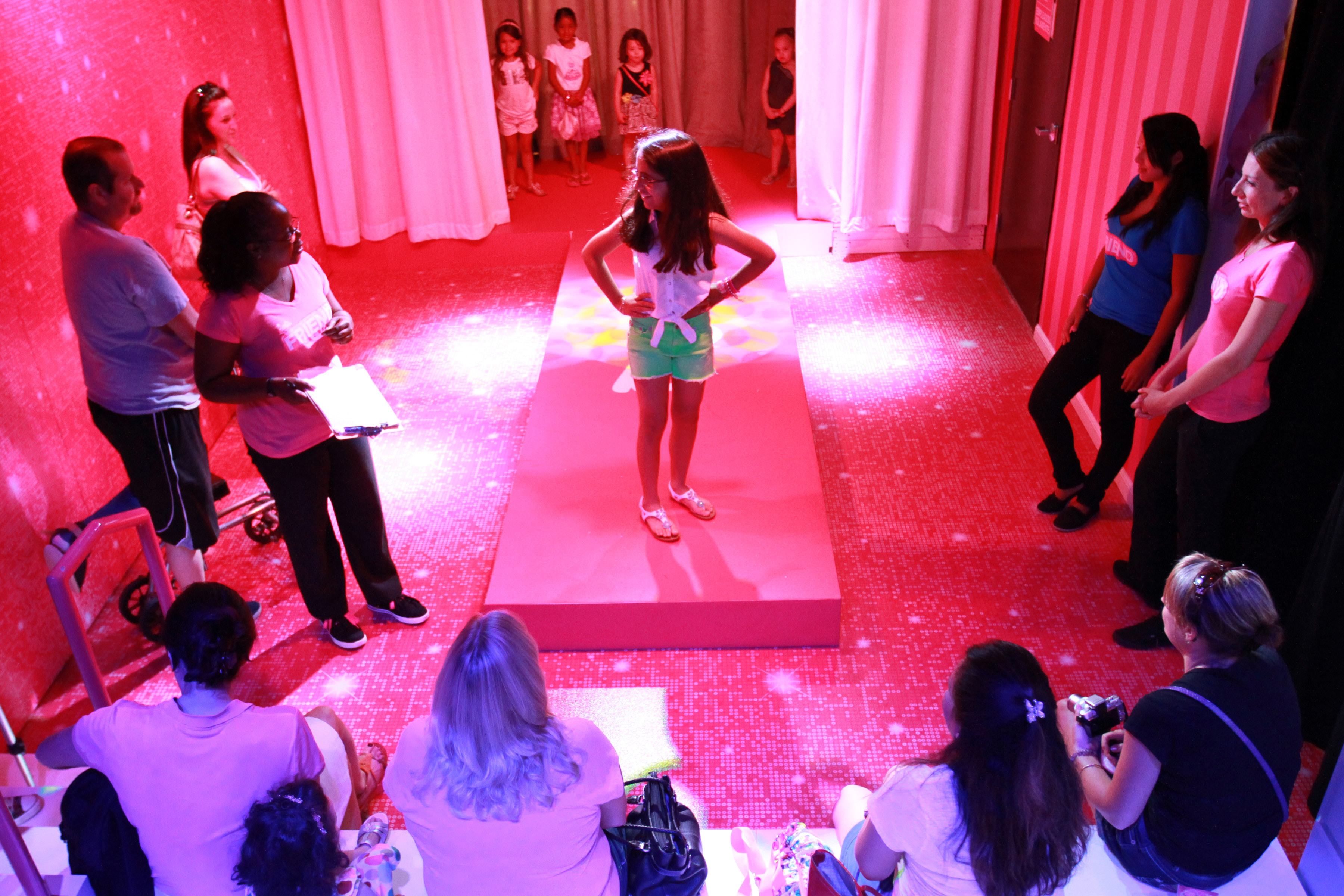 At the end of the runway in a life size house barbie the dreamhouse