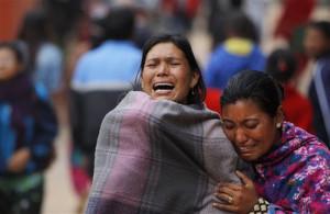 Family members break down during the cremation of an earthquake victim in Bhaktapur near Kathmandu, Nepal. (AP Photo/Niranjan Shrestha)